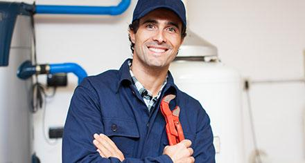 A person in a maintenance uniform.