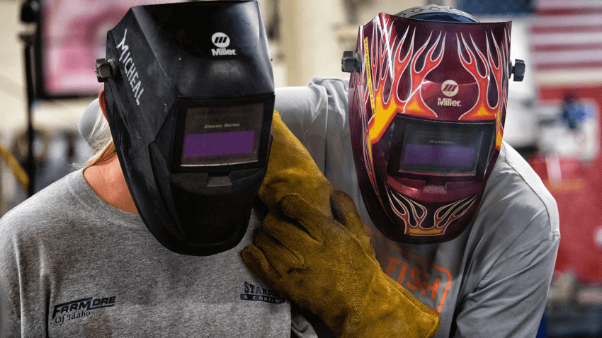 environmental industrial safety two students in welding helmets